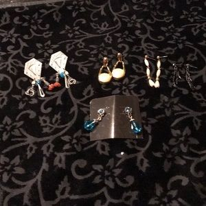 Five pairs of fashion larger gangly post earrings.